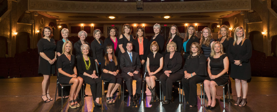 Stovall Realtors, staff photo on stage at Paramount Theatre.